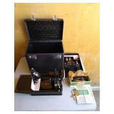 Singer brand 3 - 110 model sewing machine. Unit
