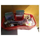 Basket of miscellaneous sewing accessories. Unit
