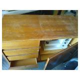 Wooden sewing cabinet with sewing machine.