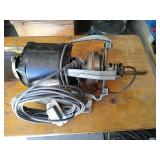 Electric motor for sewing machine. Unit includes