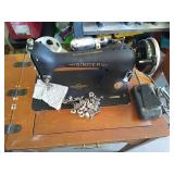 Singer sewing machine with sewing table. Serial