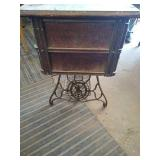 Singer brand cast iron sewing table with wooden