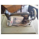 Singer sewing machine with cabinet, includes cast