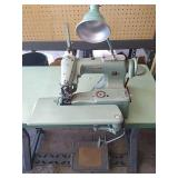 Consew model 221 sewing machine and table. Made