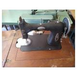 White rotary sewing machine and table. Table is