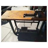 Heavy-duty sewing table with work lamp and