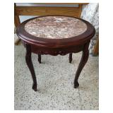 Circular side table with marble top