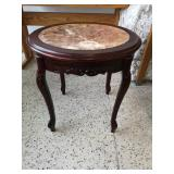 Circular wooden side table
