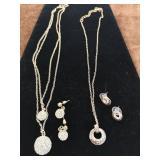 Two jewellery sets necklace and earrings