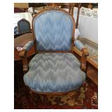 Lovely wooden sitting chair with armrests.