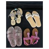 Four ladies pre-owned sandals.