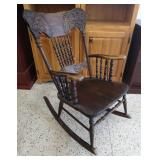 Beautiful vintage wooden rocking chair.