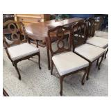 Lovely wooden oval dining table with four chairs.