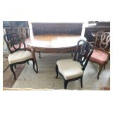 Wooden oval dining table with four chairs