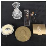 Ladies compacts, hat pins and perfume bottle.