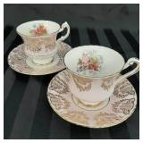 Pair of pink and gold Paragon cups and saucers