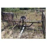 ANTIQUE HAY RAKE WITH STEEL WHEELS AND SEAT