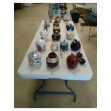 Tea pots, cookie jar, and cup and saucer.
