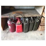 (5) Gas Cans. (1) Sprayer