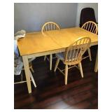 Dining room table with one leaf and four chairs