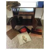 Small TV stand with cassette cases and records