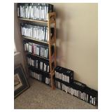 Large assortment of VHS tapes and stand