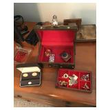 Small jewelry box with cufflinks, and chain, belt