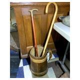 2 Walking Canes in a Lg. Wood Mug
