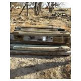 Pile of Wood Posts and Railroad Ties