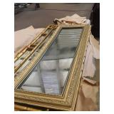 Gold framed mirrors and table