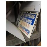 Pile metal and plastic signs