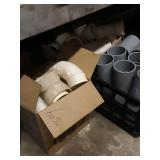 More plastic pipe fittings and partial buckets of