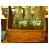 6 Empty Coca Cola Bottles in a Pepsi Cola Box