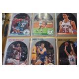 Baseball, Basketball and Football cards in binder