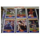 Football and Baseball cards in binder