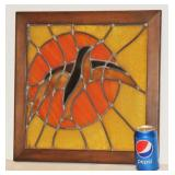Stained Glass of Bird Flying by Sun