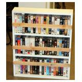 Lot of VHS Movies in Wood Shelf -A