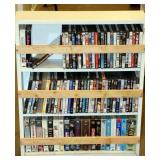 Lot of DVD & VHS Movies in Wood Shelf