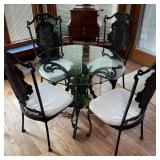 CAST IRON AND GLASS TABLE W/ CHAIRS