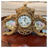 GILT ORMULU CLOCK WITH PORCELAIN FACE