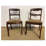 Pair of vintage carved wood chairs