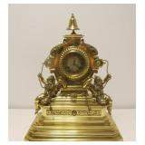 Antique Brass Figural Clock With Bell Finial.