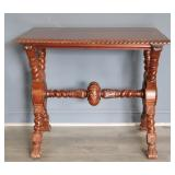 Highly Carved X Base Table.
