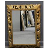 Antique Carved Giltwood Italian Mirror .
