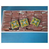 Box of Talavera style clay tiles