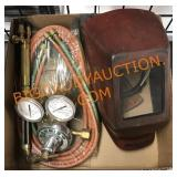 Welding helmet with cutting torch and gauges