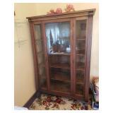 Antique oak china cabinet with original key.