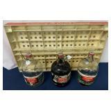 (4) Coke one gallon syrup bottles & Coke shelf