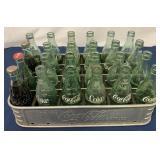 Coca Cola metal carrier w/ numerous Coke bottles