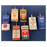 lot of 7 oil cans